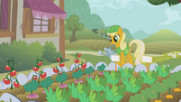 Mary Gold tending to a garden S1E10