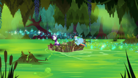 Ranbow and Rarity speed across the swamp S8E17