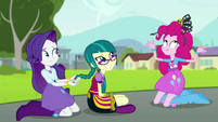 Rarity braids Juniper's hair; Pinkie puts on Juniper's headband EGS3