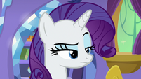 Rarity raises her eyebrow at Spike S9E19