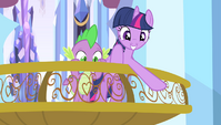 Twilight pointing off the balcony S4E24