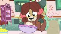 Yona stirring cupcake batter S9E7