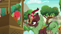 Dark-red Kirin levitating a fruit S8E23