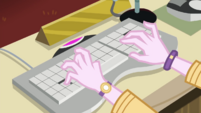 Principal Celestia typing on a keyboard EGDS37