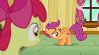 Scootaloo staring at her cutie mark while flapping her wings S6E4