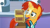 Sunburst pulls a book from his saddlebag S6E2