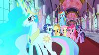The ponies watch the door open S2E01