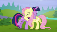 Twilight and Fluttershy hugging S5E23