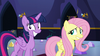 Twilight smiles and Fluttershy nervouly smiles S5E11