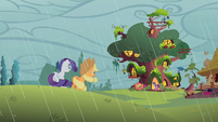 Applejack and Rarity look at the library S1E08