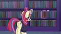 Moon Dancer places book back on the shelf S5E12.png