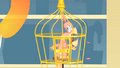 Philomena in her cage S01E22.png