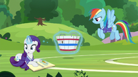 Rarity stops sketching in her sketch book S8E17