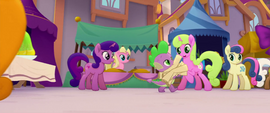 Spike running with armfuls of scrolls MLPTM