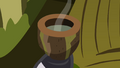 Cup now filled with a drink S3E05.png