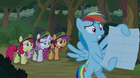 Rainbow Dash holding the map S9E13