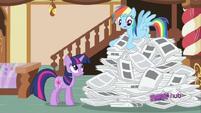 Rainbow Dash searching through paper pile S2E23