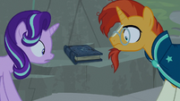 Starlight and Sunburst look at Star Swirl's journal S7E25