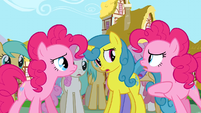 Pinkie Pie talking to another Pinkie Pie in front of the crowd S3E3