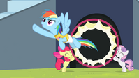 Rainbow Dash flying through the hoop S4E24