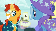 Sunburst holding up the ace of clubs S7E24