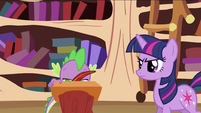 Twilight Sparkle looking at Spike writing S2E03
