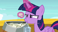 Twilight Sparkle picks up a single raffle paper S7E22