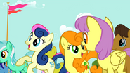 1000px-Bon Bon and Golden Harvest cheering S02E14