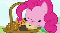 Pinkie Pie taking a bite off of one of the muffins S4E18