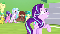 Starlight looking embarrassed at the students S8E15