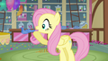 Fluttershy blowing a party horn S3E13.png