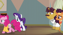 Pinkie Pie trotting past Rarity S6E12