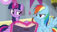 Twilight Sparkle consulting the EEA guide S8E1