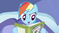 710px-Rainbow Dash reading in her bed S2E16