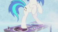 DJ Pon-3 standing on her turntable S5E9