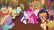 Pinkie and Rarity hug while surrounded by friends S6E12