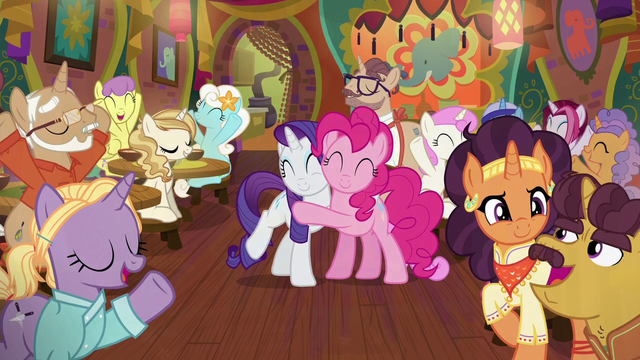 File:Pinkie and Rarity hug while surrounded by friends S6E12.png