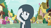 Rarity walking through Ponyville in a cloak S7E19
