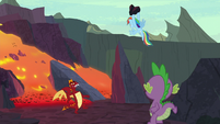 Rainbow Dash holds the rock over Garble S7E25