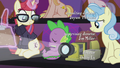 Spike sleeping next to the projector S5E25.png