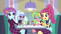 The Shadowbolts in a diner booth EGS1