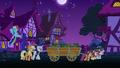Crusaders hauling cart of boxes at nighttime S6E15.png