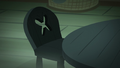 Empty seat at the tea party table S5E21.png
