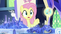 Fluttershy looks at image of Meadowbrook's mask S7E25