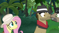 Fluttershy standing behind Biff S9E21