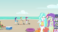 Rarity, AJ, and Rainbow searching the beach EGDS15