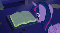 Twilight sees a dusty old book S5E12