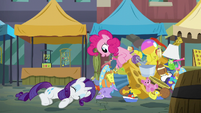 Pinkie Pie pops out of the pile of toys S6E3