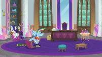 Rainbow Dash looks under a footstool S8E17