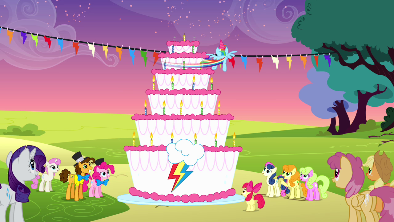 Image Rainbow spinning around the cake to blow all the candles